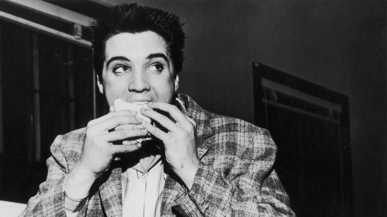 Elvis eating pizza