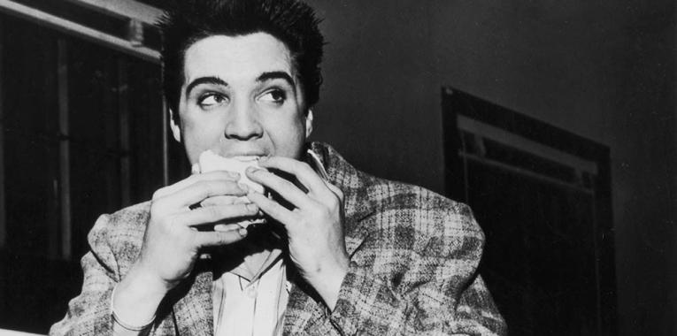 Elvis eating pizza